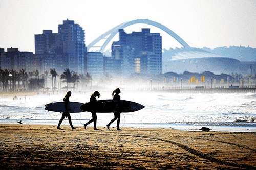 Surfers on Durban Beach
