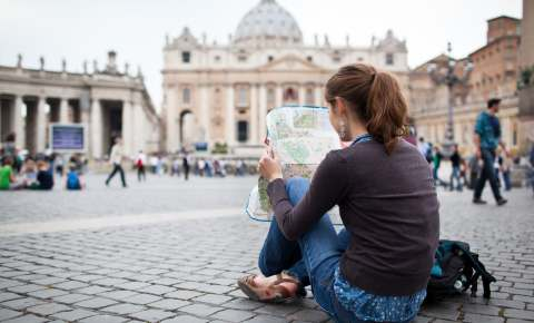 Student reading a map